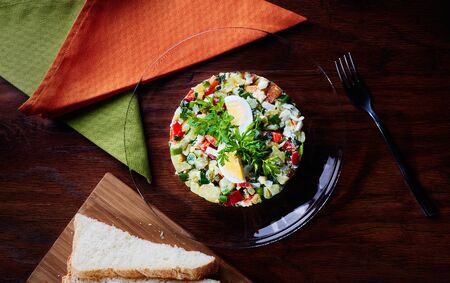 Photo pour Olivier Salad or Russian Salad with Salmon and Red Caviar - image libre de droit