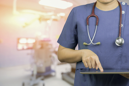 Health,Healthcare,Medicine,medical,medical Doctor or surgeon using digital tablet in operating room,Health Check with digital system for patient with tablet,Doctor,patient registration,selective focus