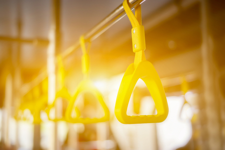 Handle on ceiling of bus, a train, MRT, prevent toppling.underground railway system,vintage color ,copy space