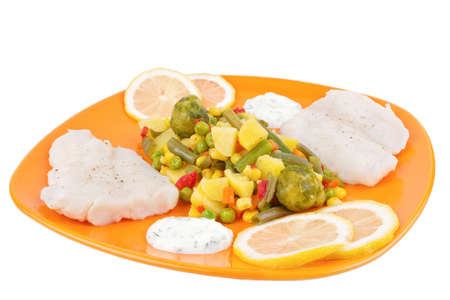 Mixed vegetables and fish on orange plate isolated on white background