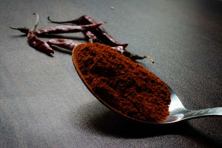 Indian Garam masala powder in bowl and it's ingredients colourful spices. Served over moody background. selective focusの素材 [FY310152468071]