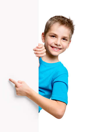 Photo for Portrait of happy little boy with white blank isolated on white background - Royalty Free Image