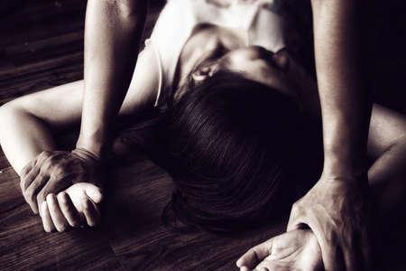 Photo pour man are using force to coerce and rape woman .stop sexual violence against women campaign. - image libre de droit