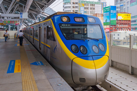 TAICHUNG, TAIWAN - JULY 19: This is a typical Taiwanese train stopped at Taichung main station waiting for passengers to board on July 19, 2017 in Taichung
