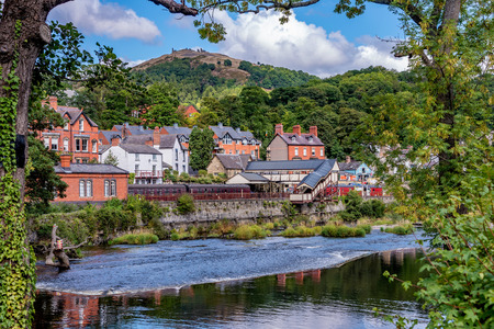 Foto de View of historic railway station river scenery in Llangollen town, UK - Imagen libre de derechos