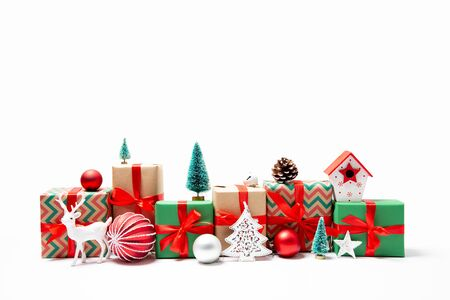 Photo pour Christmas gifts and ornaments in a row in the shape of a cityscape. Isolated on white - image libre de droit