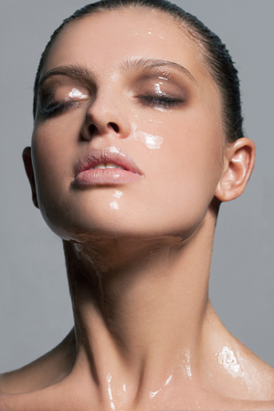 Photo for Girl with a silicone mask on her face - Royalty Free Image