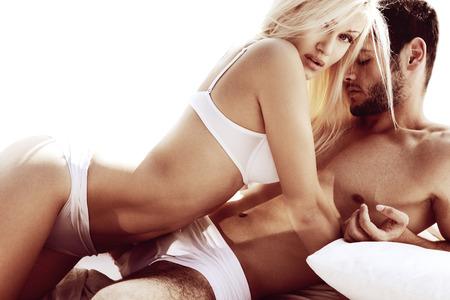 Photo pour Sexy young passionate couple - image libre de droit