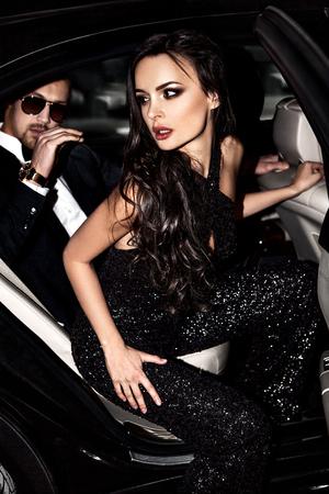 Foto de Sexy couple in the car. Hollywood stars. - Imagen libre de derechos