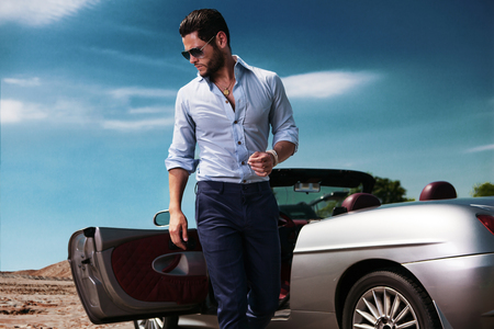 Photo for Handsome man near the car. Luxury life. - Royalty Free Image