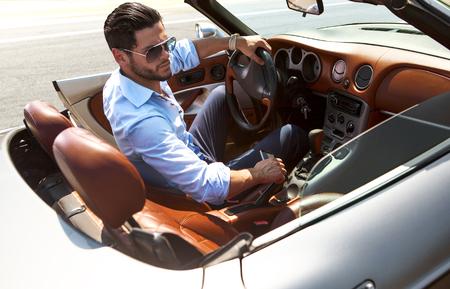 Photo pour Handsome man near the car. Luxury life. - image libre de droit