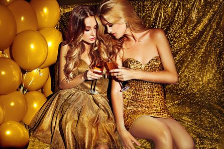 Sexy girls on lounge. Celebrating.