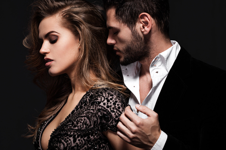 Photo pour Sexy elegant couple in the tender passion. - image libre de droit