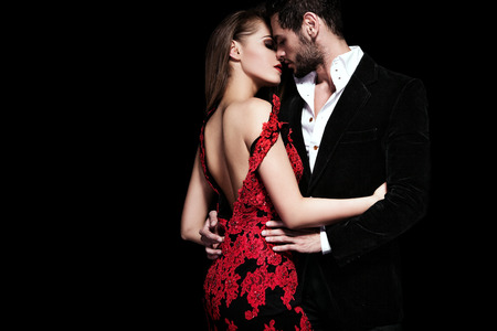Foto de Fashion photo of sexy elegant couple in the tender passion - Imagen libre de derechos