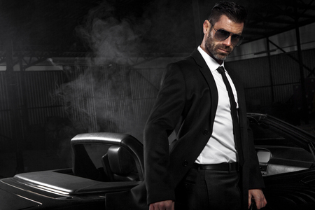 Foto de Handsome brutal man in the car. Luxury. Night life. - Imagen libre de derechos