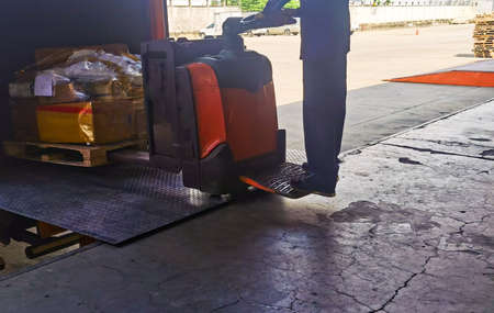 Photo for Worker driving forklift loading and unloading shipment carton boxes and goods on wooden pallet from container truck to warehouse cargo storage in logistics and transportation industrial - Royalty Free Image
