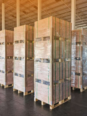 Photo for Shipment cartons box on pallets and wooden case on forklift in interior warehouse cargo for export and sorting goods in freight logistics and transportation industrial - Royalty Free Image