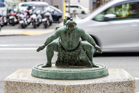 TOKYO, JAPAN - OCTOBER 8, 2018. The Bronze Figure Statue Of Japanese Sumo Wrestler on the Street.
