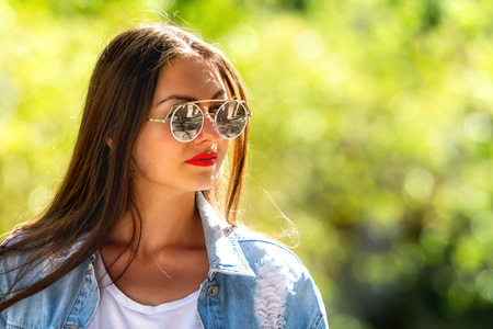 Photo for Outdoor portrait of beautiful, emotional, young woman in sunglasses. Soft background. Copy space - Royalty Free Image