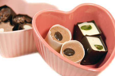 chocolate truffles in heart shaped dishes