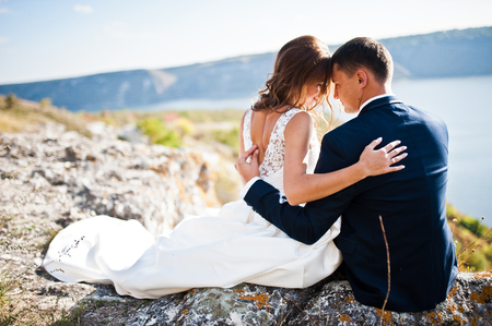 Very sensual and gorgeus wedding couple on the picturesque landscapes