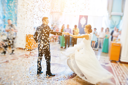 Photo for First wedding dance with golden confetti - Royalty Free Image