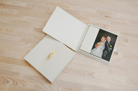 Wedding photo book and album on wooden backgroundの写真素材