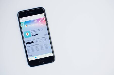 Kyiv, Ukraine - Jul 11,2017: Apple iPhone 7 with Periscope application on the screen at App Store isolated on white.
