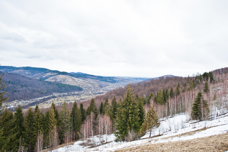 Snowy mountain valleys at Carpathian mountains. View of Ukrainian Carpathians and Yaremche from the top of Makovitsa.