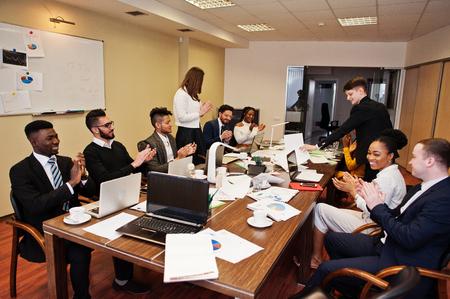 Foto für Multiracial business team meeting around boardroom table, clap hands. - Lizenzfreies Bild