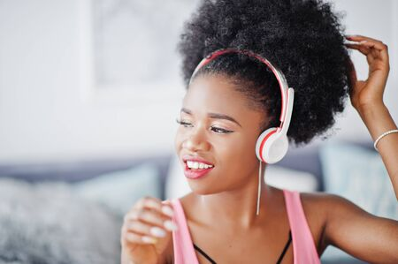Photo for Young african american woman listen music on earphones. - Royalty Free Image