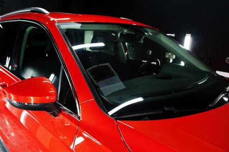 Photo pour Nice and new orange sport suv car in modern garage. - image libre de droit