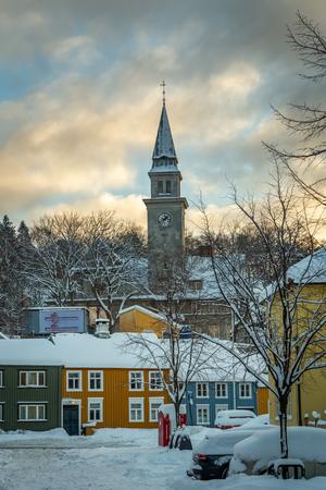 Baklandet street under snow. Wintertime in Trondheim, Norway. Colorful town buildings, original old town look.
