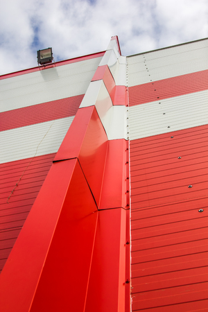 Photo for Made of red and white sandwich panels. Visible structure of the seam between the panels. - Royalty Free Image