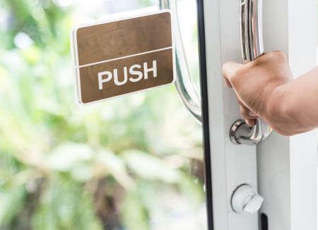 hand push the door - hand focused