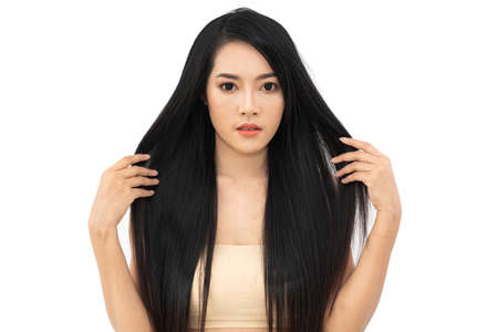 Photo pour Beautiful woman beauty health care with black long shiny straight smooth hair isolated on white background.Hair cosmetics - image libre de droit
