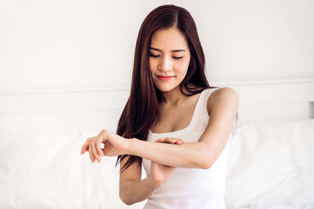 Photo for Beautiful woman beauty health care.beauty and spa.perfect fresh skin.woman touch her arm on the bed at home - Royalty Free Image