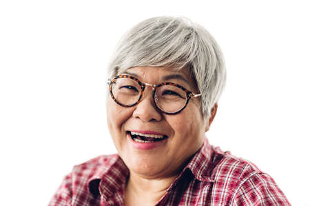 Photo for Portrait of happy senior adult elderly asia women smiling and looking at camera on white background.Retirement concept - Royalty Free Image