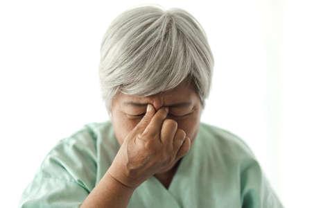 Photo pour Senior adult elderly asia women serious depressed and feeling headache, thinking of problems on white background - image libre de droit