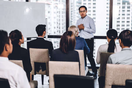 Photo pour Businessman standing in front of group of people in consulting meeting conference seminar at hall or seminar room.presentation and coaching concept - image libre de droit