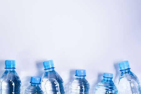Photo for Several drinking water bottles on white background. Eco concept. Copy space for your text. - Royalty Free Image