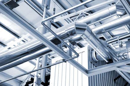 Photo pour new shiny pipes in industrial boiler room - image libre de droit