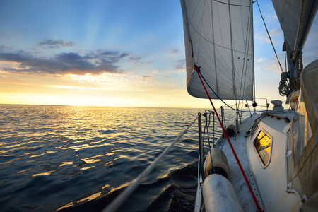 Photo pour View from the deck of a yacht sailing in calm baltic sea at th evening - image libre de droit