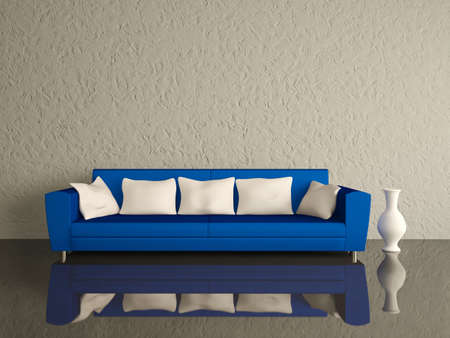 Blue sofa with white pillows and a vase near a wall
