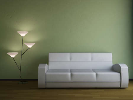 The sofa and the lamp near a wall