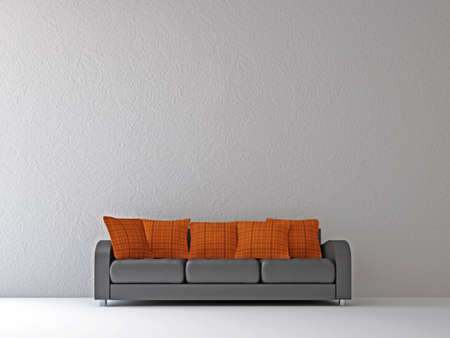 Sofa with orange pillows near the wall