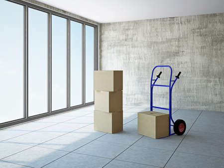 Empty room with boxes and pushcart near the window