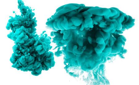 Foto de Abstract cyan cloud of silky ink in water on white isolated background. - Imagen libre de derechos