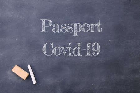 Photo pour Passport Covid-19 written on a school blackboard. - image libre de droit