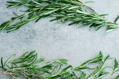 Photo for Flatlay with rosemary sprigs arranged on metallic background with text space at the center - Royalty Free Image